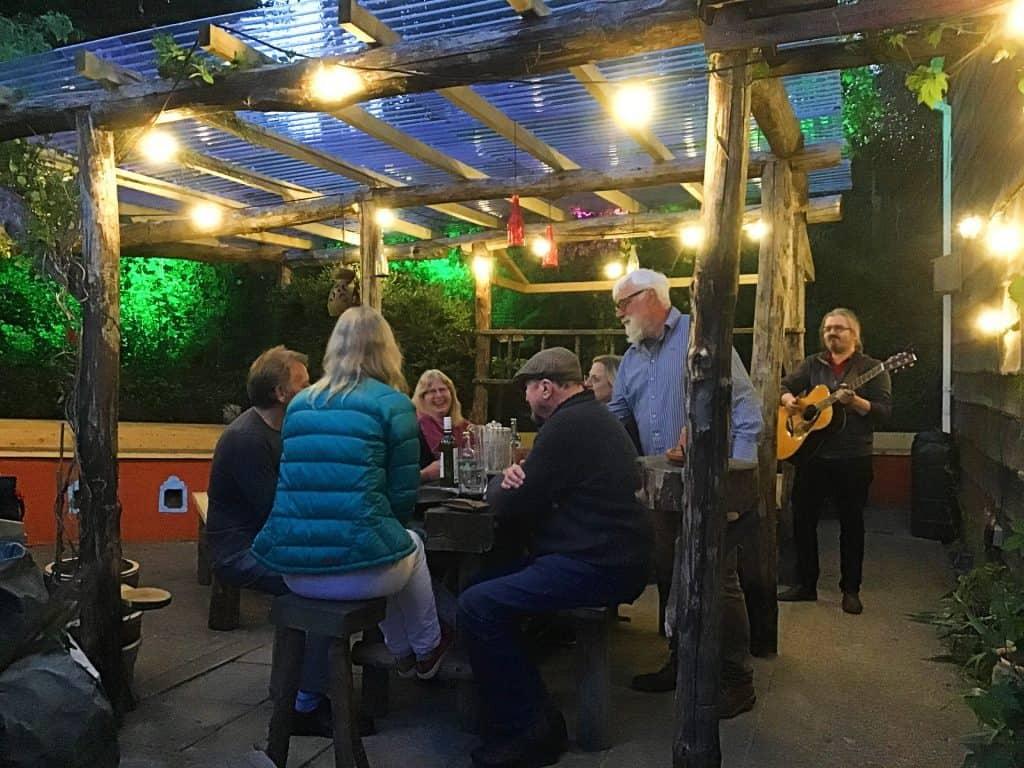 beer garden 2021 people musician